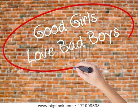 Woman Hand Writing Good Girls Love Bad Boys With Black Marker On Visual Screen