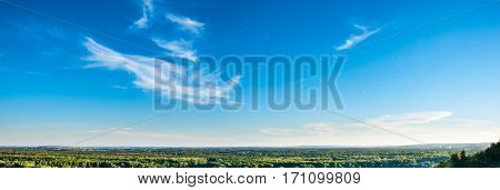 A panorama of forest till the horizon and deep clear blue sky