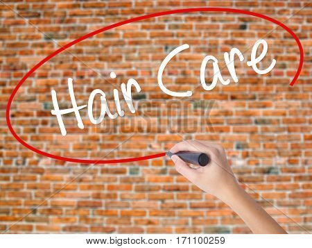 Woman Hand Writing  Hair Care With Black Marker On Visual Screen