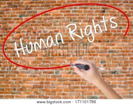 Woman Hand Writing Human Rights With Black Marker On Visual Screen
