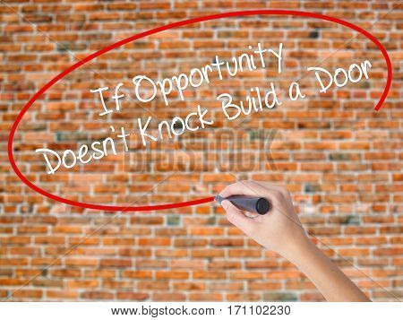 Woman Hand Writing If Opportunity Doesn't Knock Build A Door With Black Marker On Visual Screen