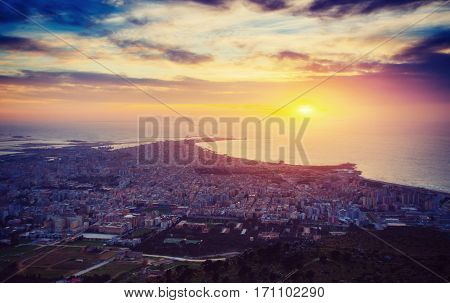 Sunset over the city from on high. The dramatic and picturesque scene. Location Trapani, Erice, Sicily, Italy, Europe. Mediterranean and Tyrrhenian Sea.