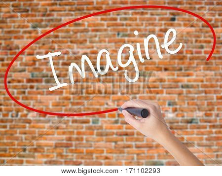 Woman Hand Writing Imagine  With Black Marker On Visual Screen
