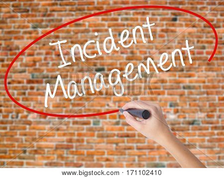 Woman Hand Writing Incident Management With Black Marker On Visual Screen
