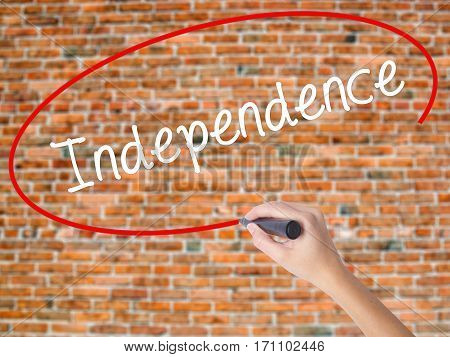 Woman Hand Writing Independence  With Black Marker On Visual Screen.