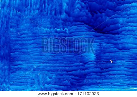 blue paint on glass abstract texture backgrounds