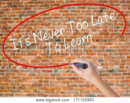 Woman Hand Writing Its Never Too Late To Learn With Black Marker On Visual Screen