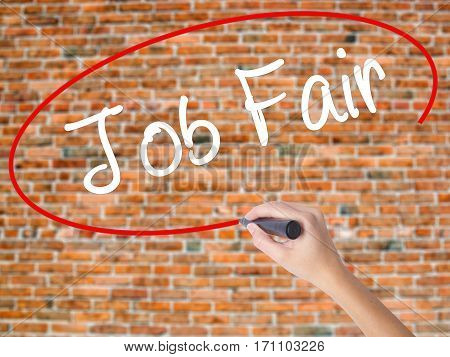 Woman Hand Writing Job Fair With Black Marker On Visual Screen