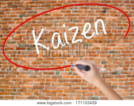 Woman Hand Writing Kaizen With Black Marker On Visual Screen