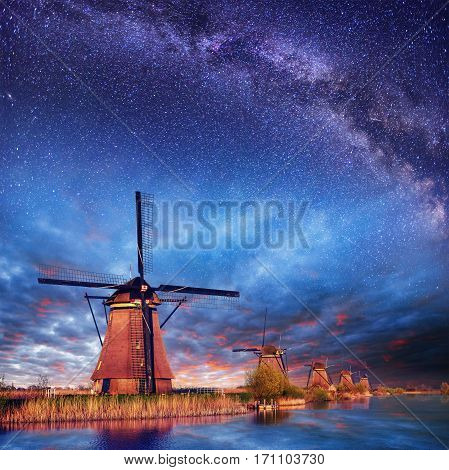 Dutch mill at night. Starry sky. Holland Netherlands