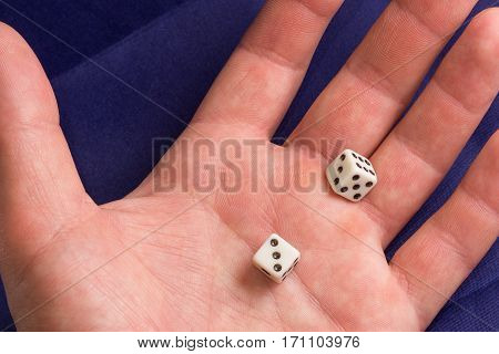 dice in the palm this small dice for board games for example such as Backgammon Monopoly