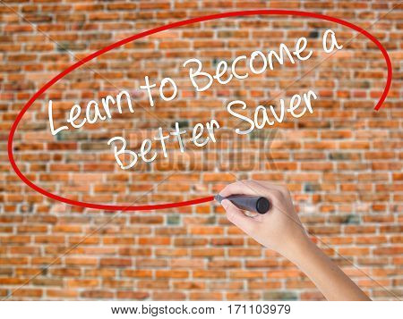 Woman Hand Writing Learn To Become A Better Saver With Black Marker On Visual Screen