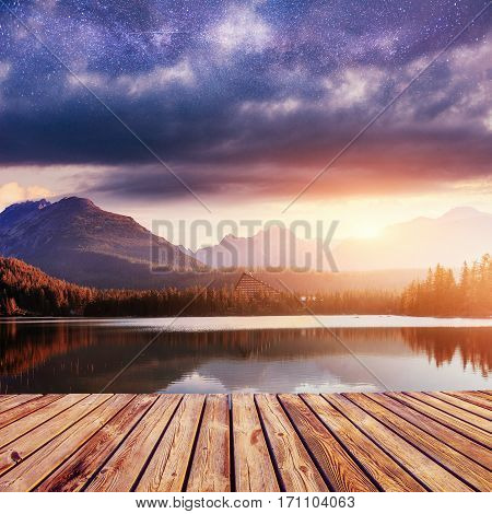 Fantastic Shtrbske Pleso High Tatras. Dutch mill at night. Starry sky. Slovakia, Europe.