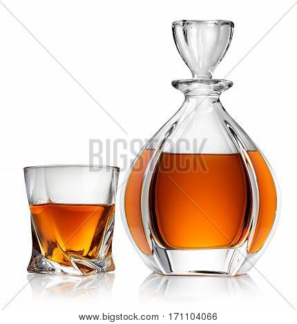Carafe and glass of whiskey isolated on a white background