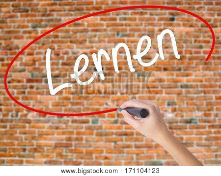 Woman Hand Writing Lernen (learn In German) With Black Marker On Visual Screen.