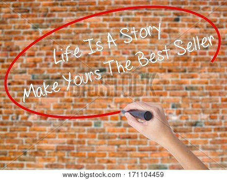 Woman Hand Writing Life Is A Story Make Yours The Best Seller With Black Marker On Visual Screen