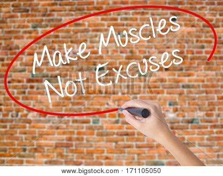 Woman Hand Writing Make Muscles Not Excuses With Black Marker On Visual Screen