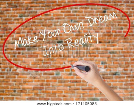 Woman Hand Writing Make Your Own Dream Into Reality With Black Marker On Visual Screen