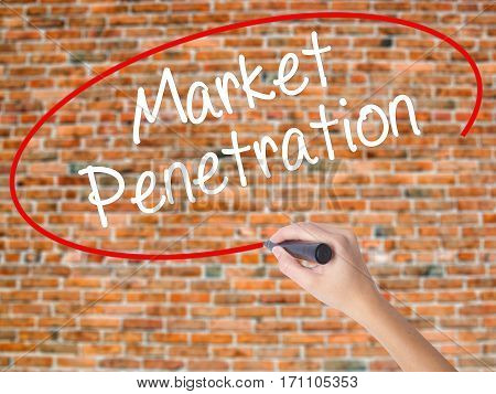 Woman Hand Writing Market Penetration With Black Marker On Visual Screen
