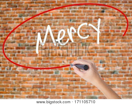 Woman Hand Writing Mercy With Black Marker On Visual Screen