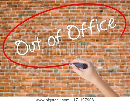 Woman Hand Writing Out Of Office With Black Marker On Visual Screen