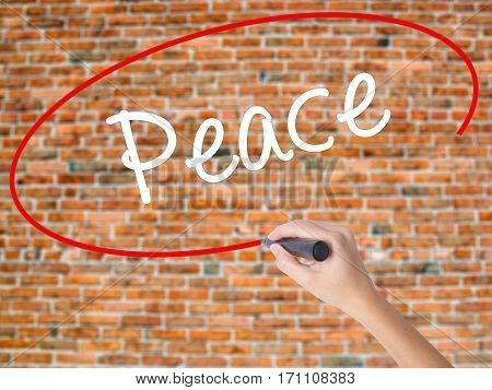 Woman Hand Writing Peace  With Black Marker On Visual Screen