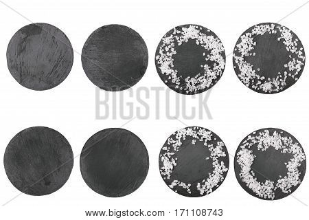 Round stone board with salt. Top view. Copy space