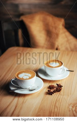 Two cups of gourmet coffee house cappuccino.