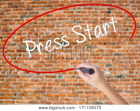 Woman Hand Writing Press Start With Black Marker On Visual Screen