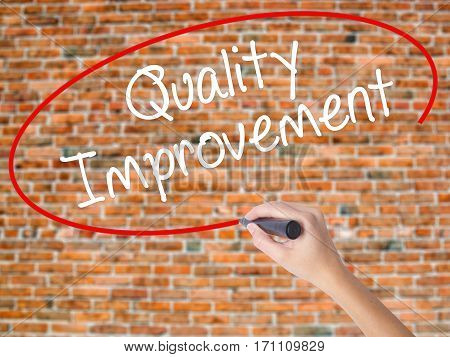 Woman Hand Writing Quality Improvement With Black Marker On Visual Screen.