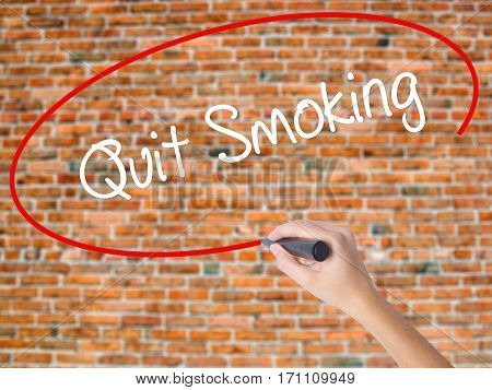 Woman Hand Writing Quit Smoking With Black Marker On Visual Screen