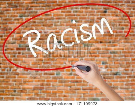 Woman Hand Writing Racism With Black Marker On Visual Screen.