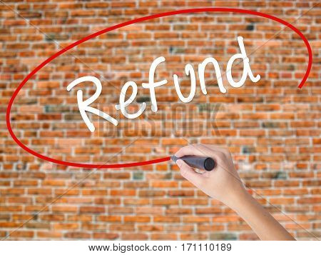 Woman Hand Writing Refund With Black Marker On Visual Screen
