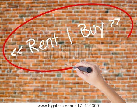 Woman Hand Writing Rent - Buy  With Black Marker On Visual Screen.