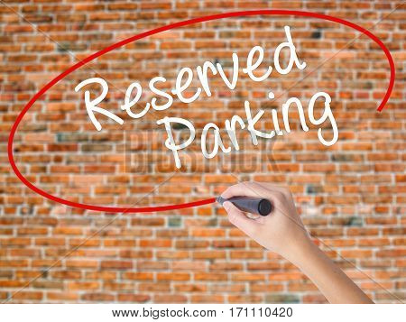 Woman Hand Writing Reserved Parking With Black Marker On Visual Screen