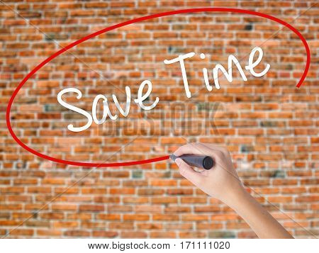 Woman Hand Writing Save Time With Black Marker On Visual Screen