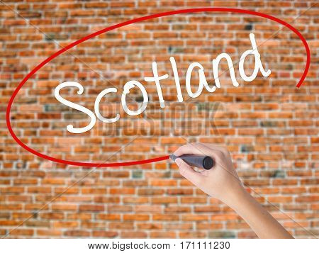 Woman Hand Writing Scotland With Black Marker On Visual Screen.