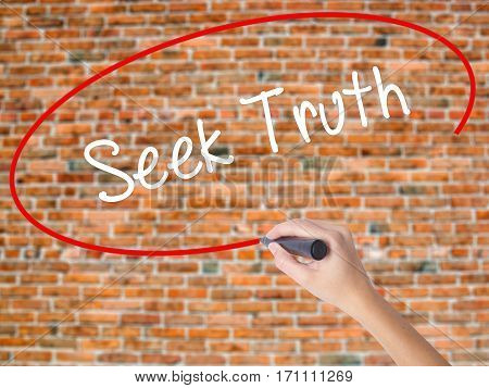 Woman Hand Writing Seek Truth With Black Marker On Visual Screen