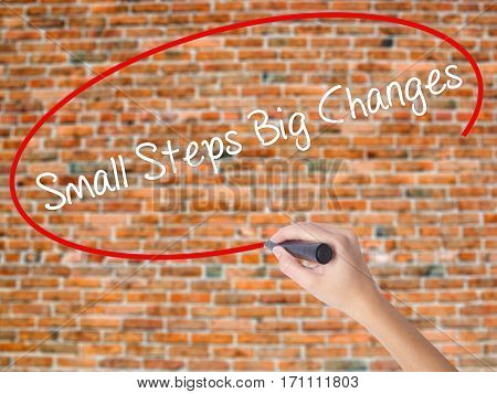 Woman Hand Writing Small Steps Big Changes With Black Marker On Visual Screen