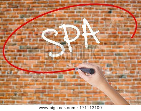 Woman Hand Writing Spa With Black Marker On Visual Screen