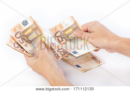 Close up of female hands counting 50 euro banknotes isolated on white background