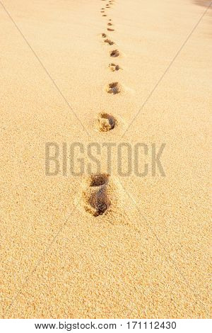 Footprints on the beautiful ocean sand. Set of pictures showing ocean waves in different stages over footprints. Cabo San Lucas. Mexico.