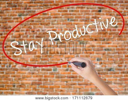 Woman Hand Writing Stay Productive With Black Marker On Visual Screen