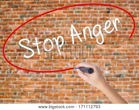 Woman Hand Writing Stop Anger With Black Marker On Visual Screen