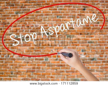 Woman Hand Writing Stop Aspartame With Black Marker On Visual Screen