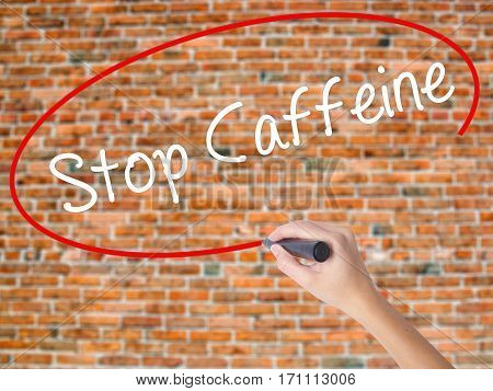 Woman Hand Writing Stop Caffeine With Black Marker On Visual Screen