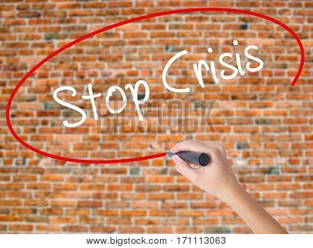 Woman Hand Writing Stop Crisis With Black Marker On Visual Screen