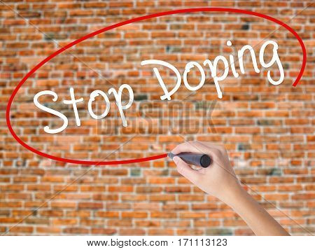 Woman Hand Writing Stop Doping With Black Marker On Visual Screen