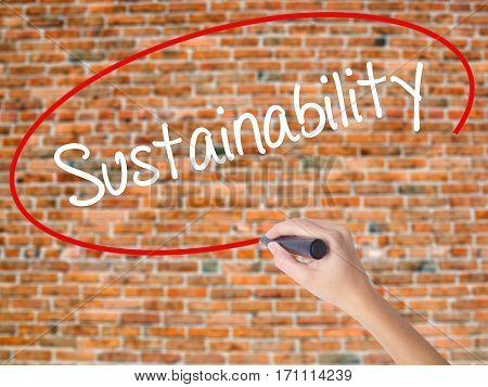 Woman Hand Writing Sustainability  With Black Marker On Visual Screen