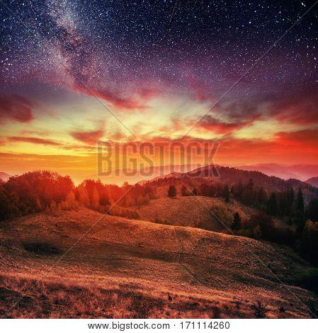 mountain range in the Carpathian Mountains in autumn night under the stars. Fantastic event. Ukraine, Europe